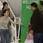 Laura Ling greets family